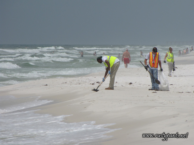 BP's oil spill cleanup workers amid the beach folks 6-5-2010